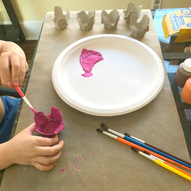 Painting egg carton flowers - the best part of this easy kid craft!
